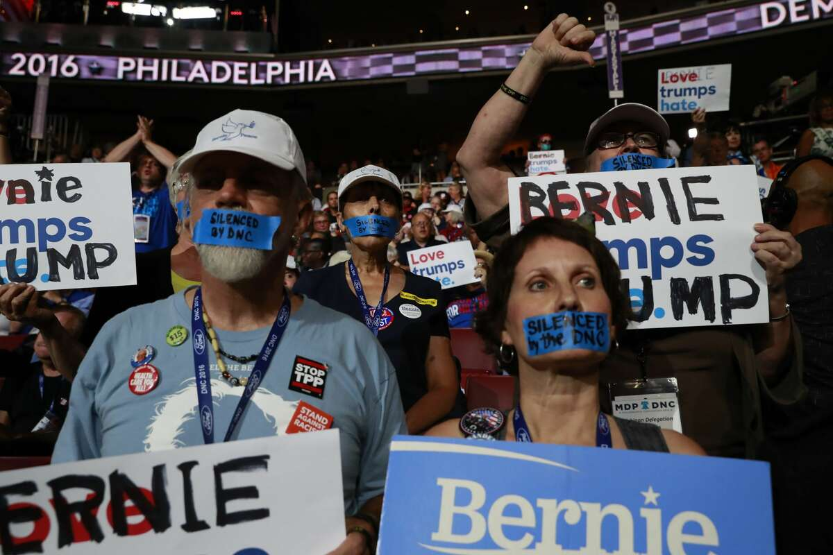 FILE -- Supporters of Bernie Sanders' presidential campaign protest during the Democratic National Convention in Philadelphia, July 25, 2016. From the progressive left to the moderate wing, President Donald Trump has served for months as the glue keeping the Democratic Party from fracturing. (Josh Haner/The New York Times)