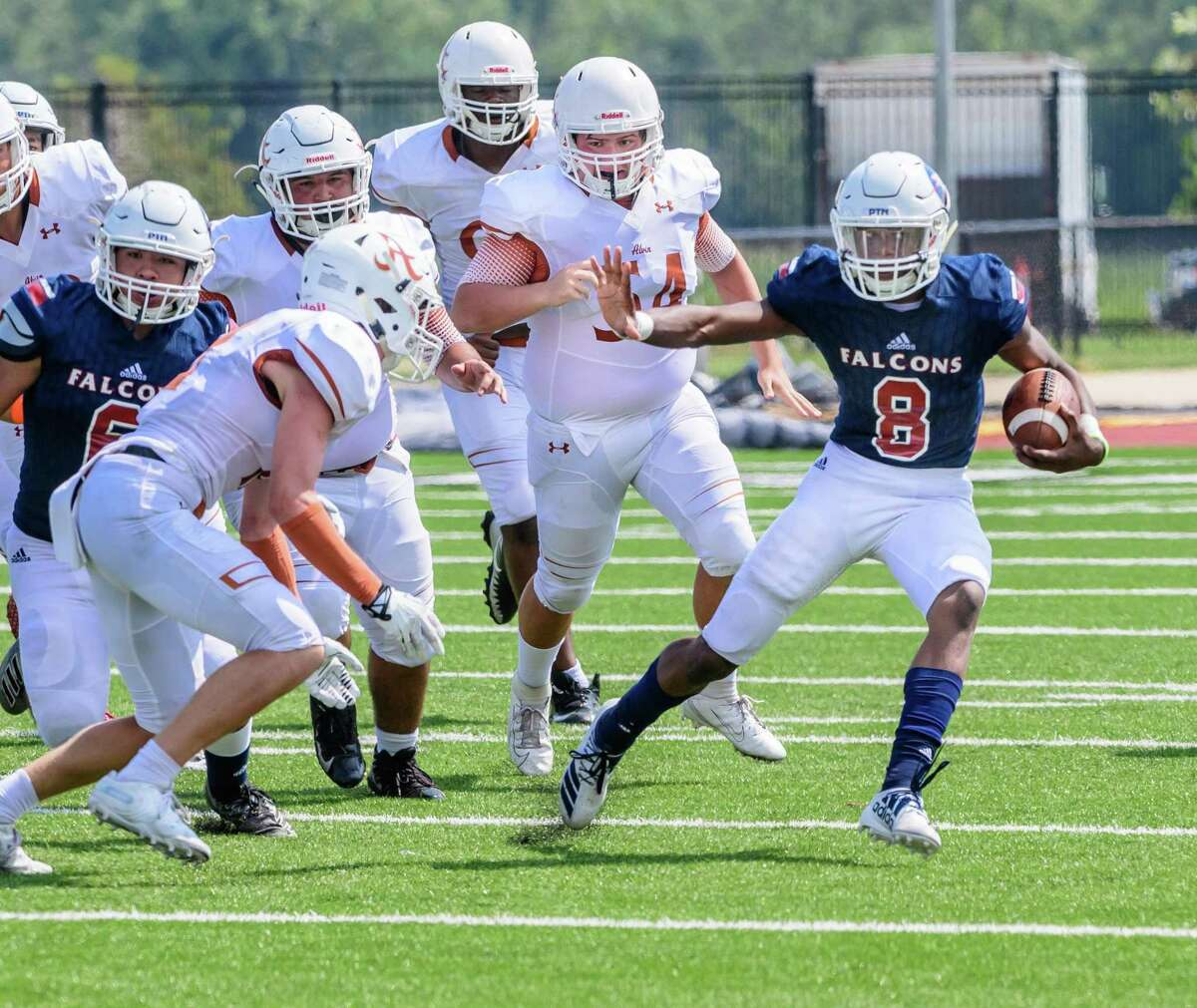 Clear Lake quarerback Tyler Durst (8) is one of the few returning offensive starters greeting head coach Larry McRae this fall.