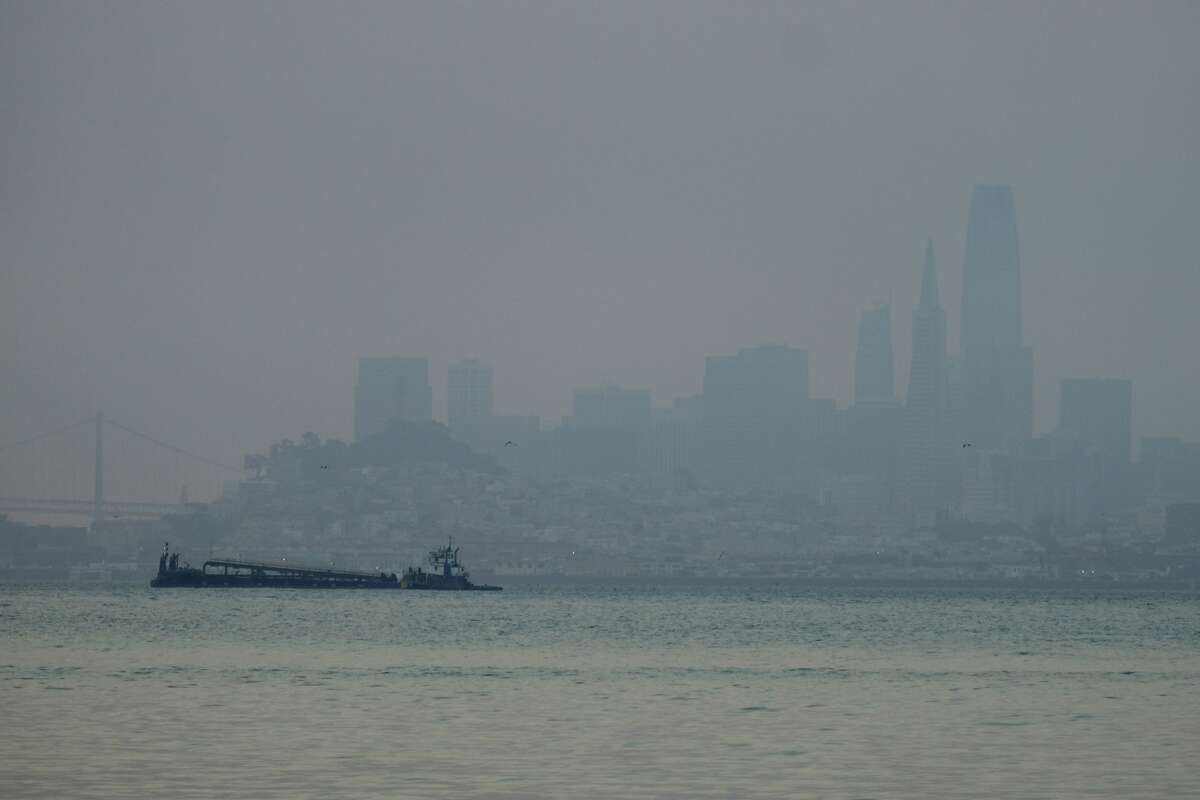 The San Francisco skyline is barely visible through smoke from wildfires Wednesday, Aug. 19, 2020, in this view from Sausalito, Calif. Thousands of people were under orders to evacuate in regions surrounding the San Francisco Bay Area Wednesday as nearly 40 wildfires blazed across the state amid a blistering heat wave now in its second week. Smoke blanketed the city of San Francisco. (AP Photo/Eric Risberg)