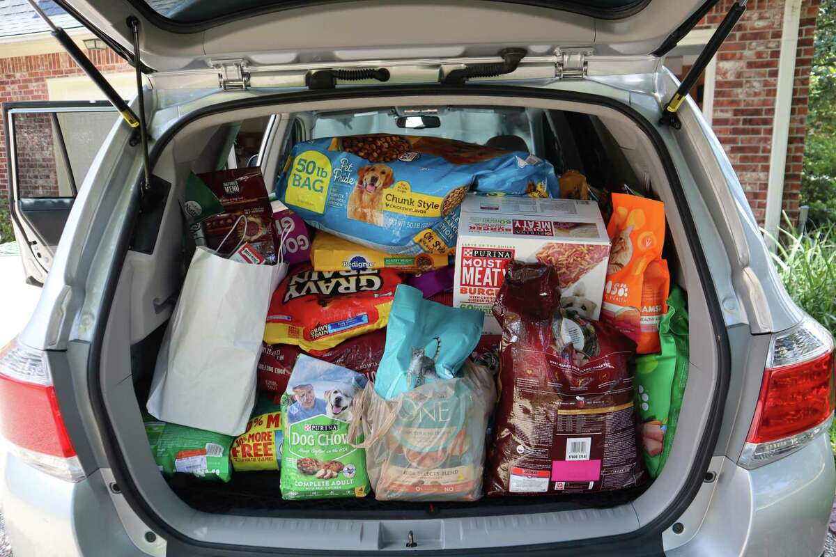 After reading about the need for more pet food donations, the North Shore Republican Women's group organized a pet food and donation drive for Meals on Wheels Montgomery County. The donations filled the sizable SUV owned by Ann Kate, the member of the group who organized the drive.