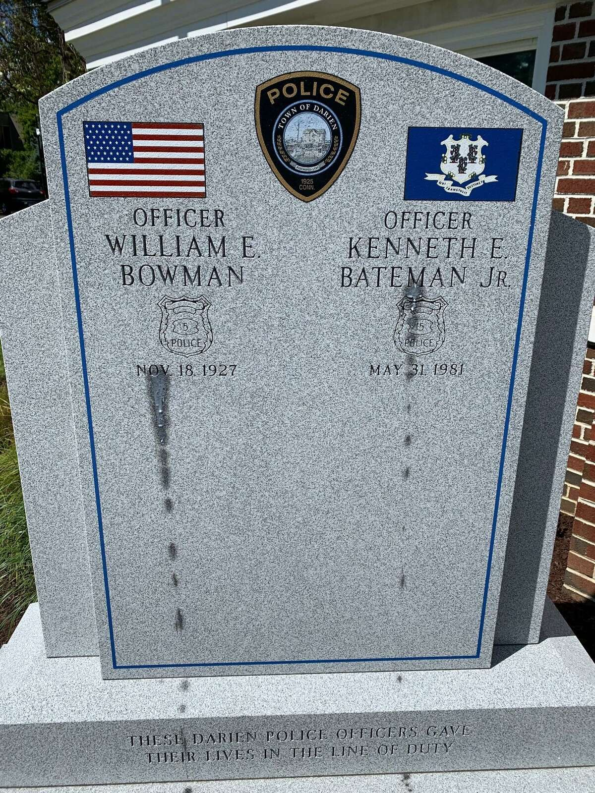 A monument dedicated to the memory of two fallen Darien police officers was defaced using what police believe to be a wax paintball gun.