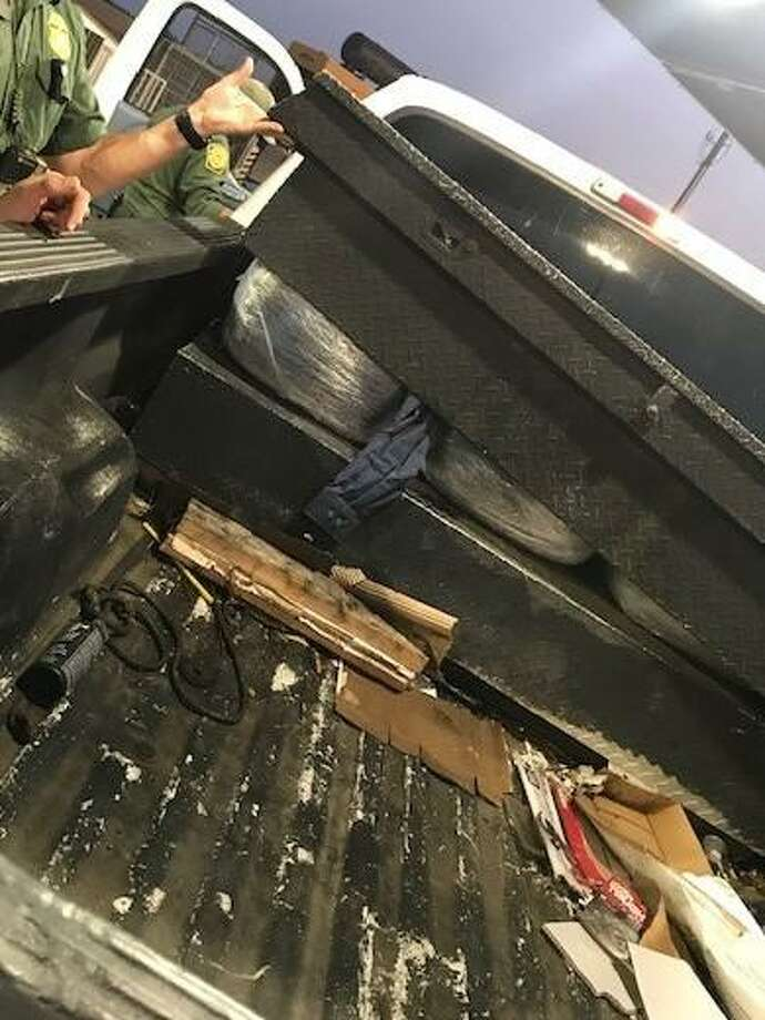 A juvenile tried to smuggle the marijuana bundles shown in this toolbox, according to the U.S. Border Patrol. Agents said the contraband weighed about 103 pounds and had an approximate value of $82,400. Photo: Courtesy Photo /U.S. Border Patrol