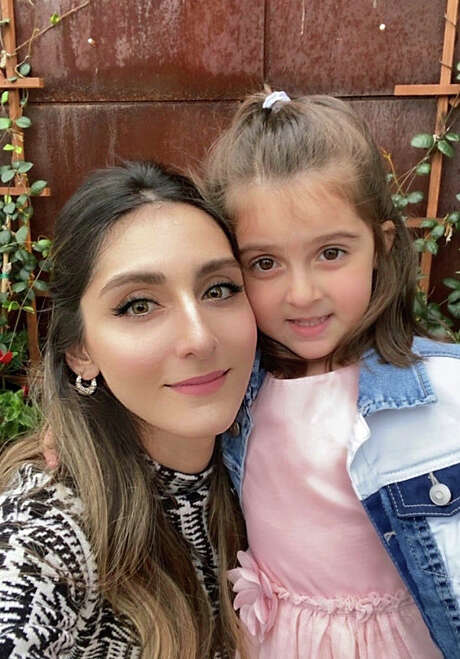 Ana Zangeneh, who supervises disease surveillance and epidemiology for Harris County Public Health, took her daughter, Donna, to the rodeo on March 5. Photo: Courtesy, Ana Zangeneh