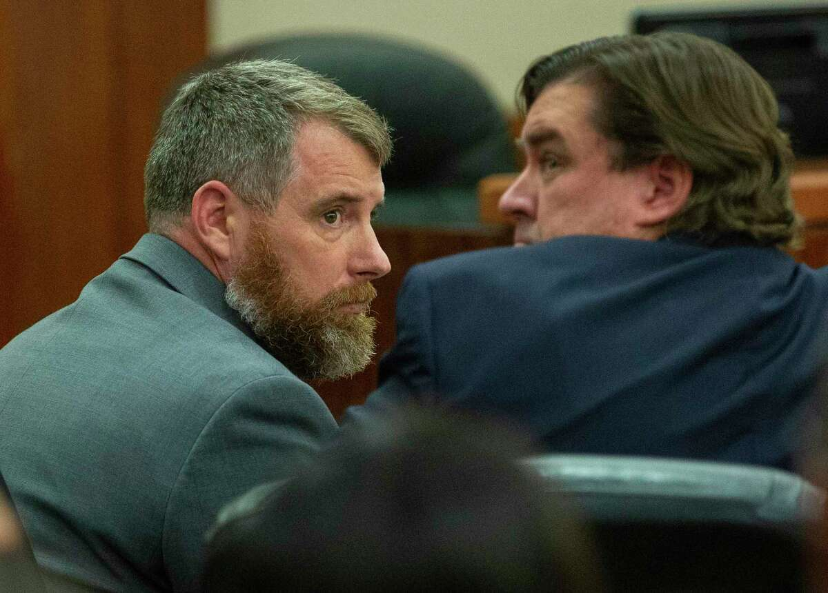 Terry Bryan Thompson (left) looks at his lawyer shortly before being told that a jury agreed on a 25-year prison sentence for him for the choking death of John Hernandez during a sentencing hearing at Harris County Criminal Court, Wednesday, Nov. 7, 2018 in Houston. Thompson was with his wife, former deputy Chauna Thompson, when they got into a fight with Hernandez. Cell phone video from the incident showed the Thompsons holding Hernandez down on the ground.
