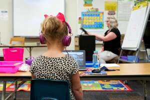The daughter of Callie Reams, Emerson Elementary kindergarten teacher, attends school repotely while her mother teacher remotely Wednesday, Aug. 19, 2020. Wednesday was the first day of school.