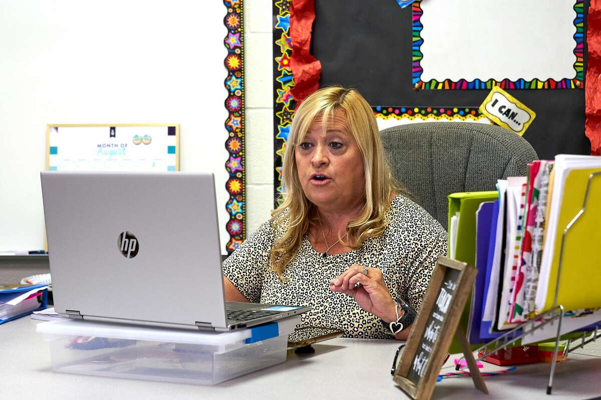 Fifth-grade reading teacher Julie Quain teaches her students remotely at Emerson Elementary on Wednesday, Aug. 19, 2020. Wednesday was the first day of school for the 2020-21 school year.