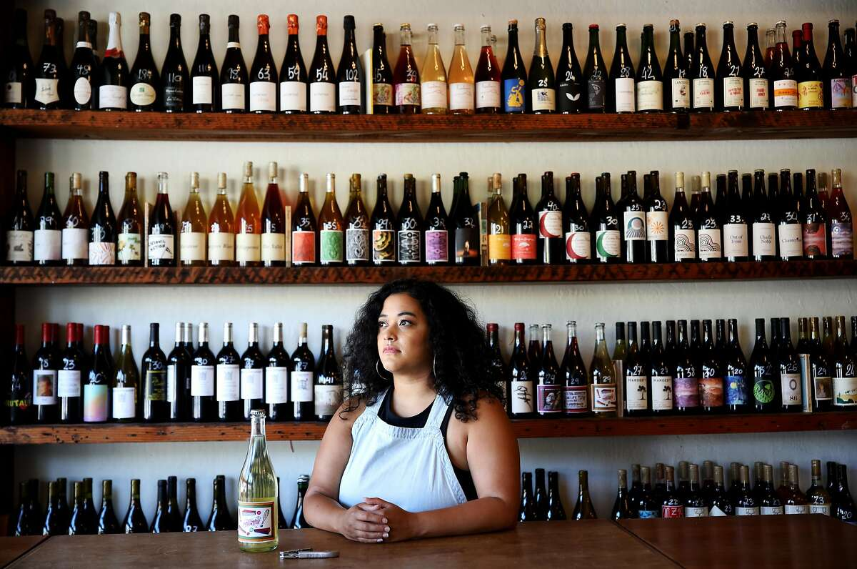 Jirka Jireh, a manager and sommelier, poses for a portrait at Ordinaire Wine Shop and Wine Bar, located at 3354 Grand Ave., on Friday, July 10, 2020, in Oakland, Calif. Jireh has begun organizing virtual wine classes for BIPOC across the country; the classes are free for all students, with the instructor donating time and wine companies donating all the wine.
