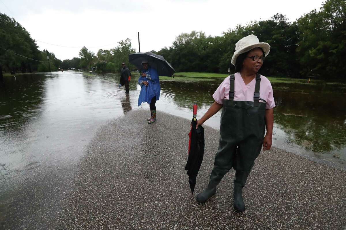 Hurricanes and tropical storms are an annual threat in Brazoria County. Pearland resident Carolyn Fyles waits after the road to her home became impassable during Hurricane Harvey in 2017.