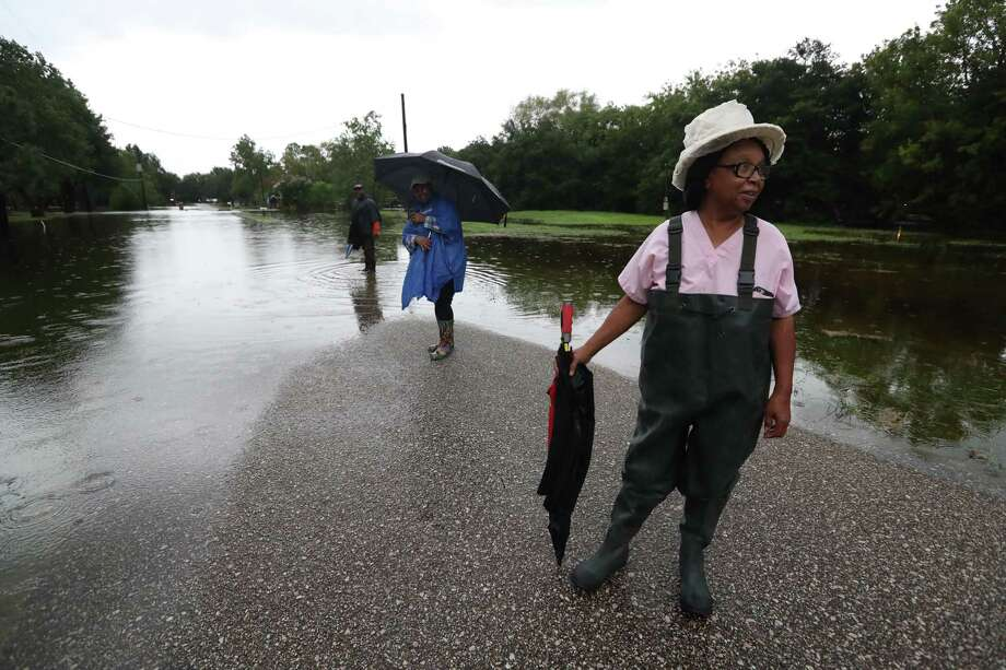 Hurricanes and tropical storms are an annual threat in Brazoria County. Pearland resident Carolyn Fyles waits after the road to her home became impassable during Hurricane Harvey in 2017. Photo: Steve Gonzales, Staff Photographer / Steve Gonzales / Houston Chronicle