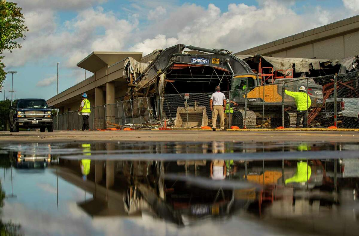 The former Sears store that existed for decades at Memorial City Mall is demolished Tuesday, Aug. 11, 2020, in Houston.