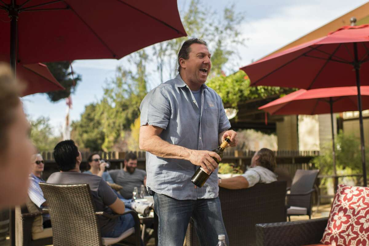 Assistant tasting room manager Philip Carruthers shares a laugh with customers at the Bernardus Winery tasting room in Carmel Valley, Calif. in November 2017.