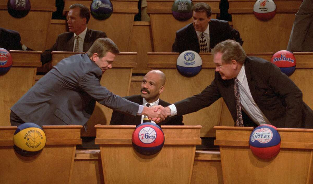 Golden State Warriors general manager David Twardzik, left, receives congratulations from Los Angeles Clippers head coach Bill Fitch, right, as Philadelphia76ers coach and general manager John Lucas, center, looks on, after Golden State received the number-one pick for the 1995 NBA Draft during the NBA Draft Lottery Sunday, May 21, 1995 in Secaucus, N.J. The 1995 NBA Draft is scheduled to be held Wednesday,June 28, at SkyDome in Toronto. (AP Photo/Paul Hurschmann)