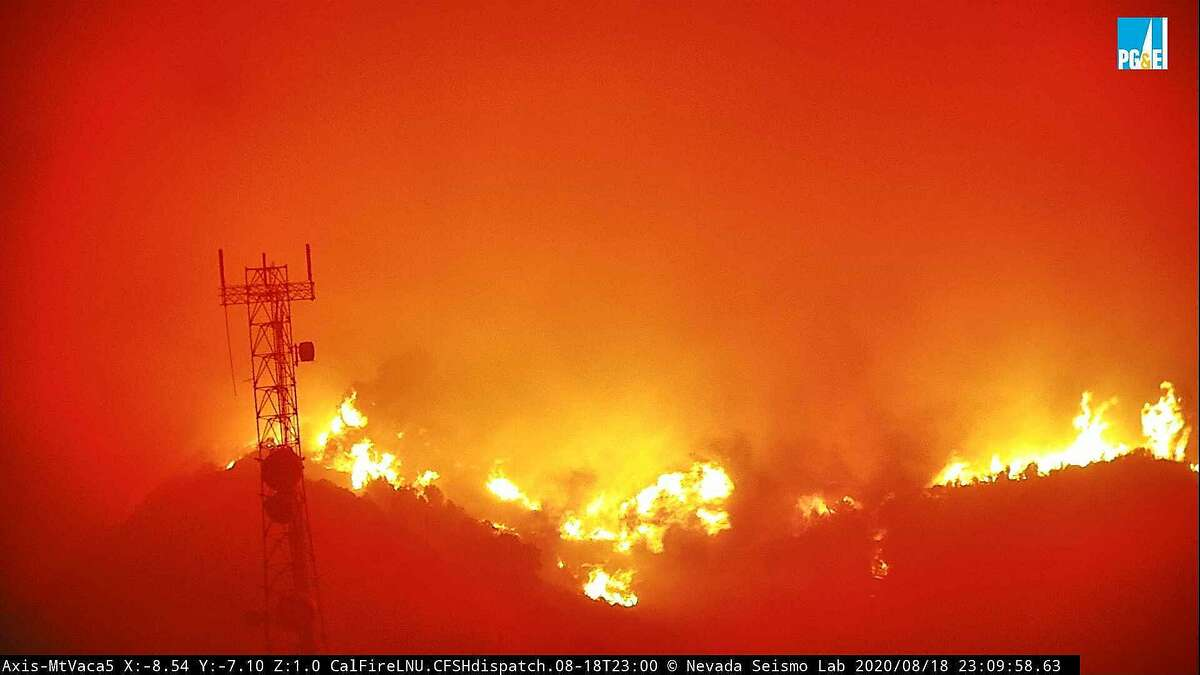 Image 6: The fire cam MtVaca5 captures the eruption of the LNU Lightning Complex fire near Vacaville on Tuesday, Aug. 18, 2020.
