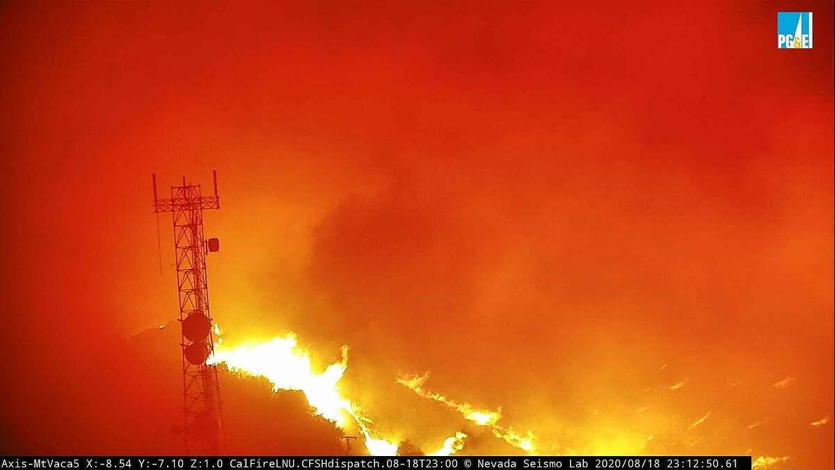 Image 7: The fire cam MtVaca5 captures the eruption of the LNU Lightning Complex fire near Vacaville on Tuesday, Aug. 18, 2020.