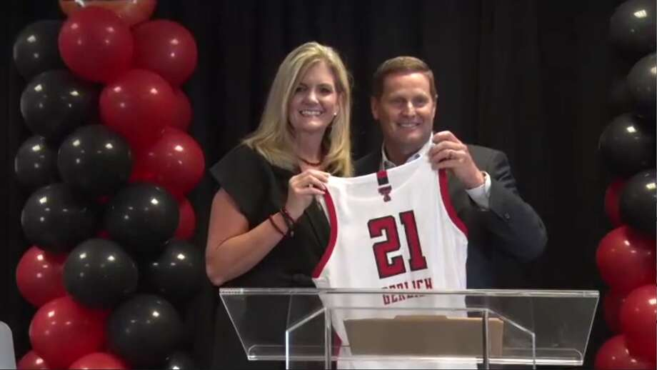 Head Texas Tech women's basketball head coach Krista Gerlich holds up a jersey along with TTU athletic director Kirby Hocutt during Gerlich's introductory press conference that was held on Zoom on Wednesday. Photo: Screenshot By Nathan Giese/Plainview Herald