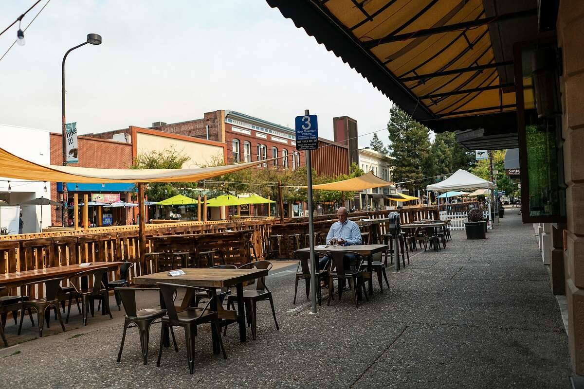 Diners sit outside in the outdoor seating set up downtown Santa Rosa, California, August 19, 2020.