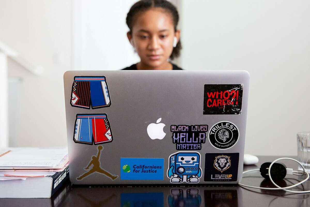 A variety of stickers decorate the back of Aniyah Story's laptop at her home in San Leandro, Calif. on August 17, 2020. Story is an advocate for bill AB2016, which will make ethnic studies a graduation requirement for high school students. Currently lawmakers are divided over the bill, saying that while they agree ethnic studies should be expanded there is disagreement over what lessons the curriculum should include.
