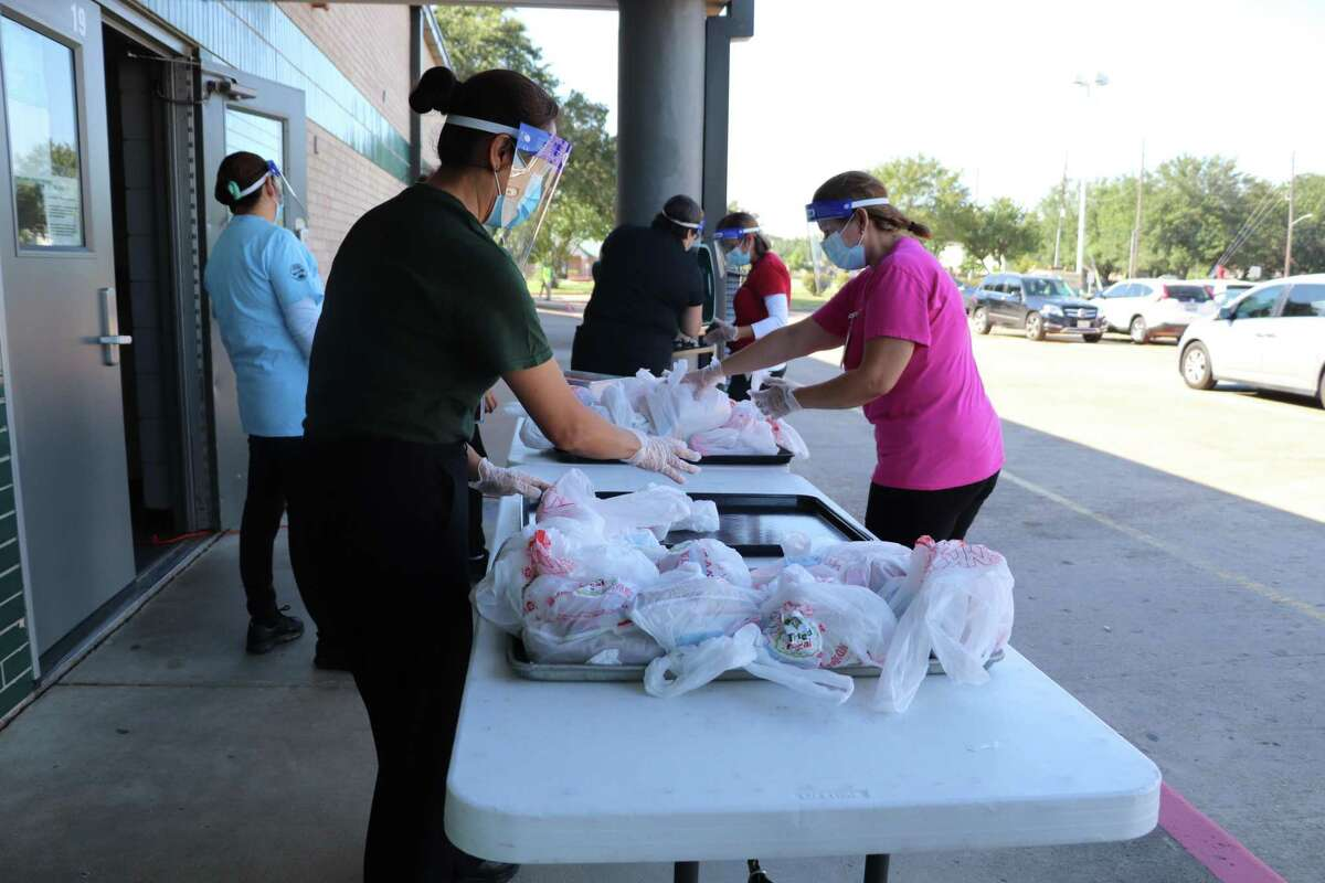 Katy Independent School District staff members distribute Grab and Go curbside meals on Wednesday, Aug. 19.