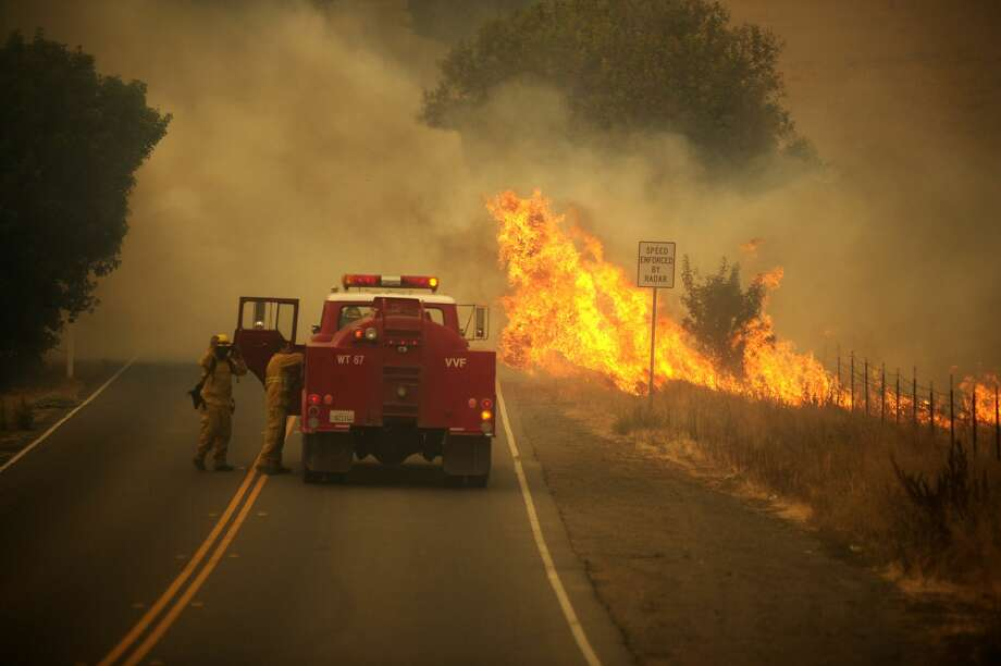 A view of the site of the Hennessey Fire exploded Tuesday afternoon and nearly doubled in size in a matter of minutes, on August 19, 2020 in Vacaville, California, United States. Many homes were lost along Pleasants Valley Rd however fire fighters were able to hold the fire to a hill behind the home along Wycoff Dr in the Wycoff-North Alamo area of Vacaville. (Photo by Neal Waters/Anadolu Agency via Getty Images) Photo: Anadolu Agency/Anadolu Agency Via Getty Images / 2020 Anadolu Agency