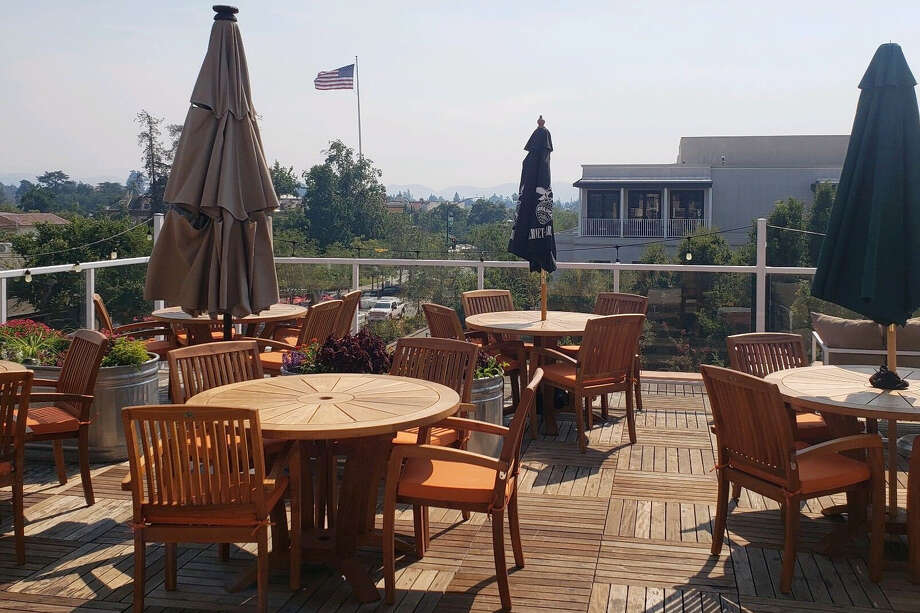 Poor air quality caused by wildfires raging across Northern California led Aviation Rooftop Bar & Restaurant in Livermore to close on Wednesday. Overlooking hazy skies, the restaurant's patio remained empty all day. Photo: Theresa Dobbs