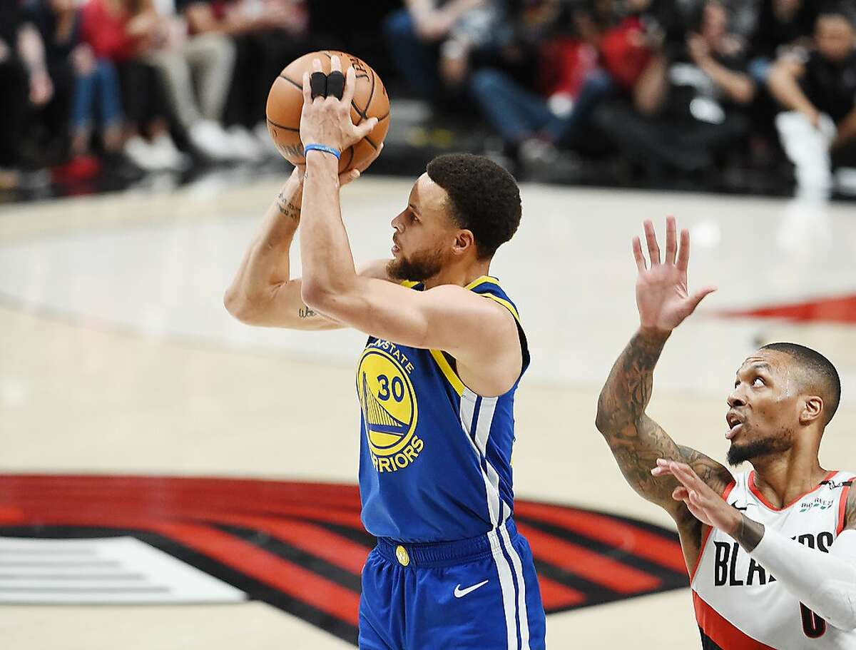 PORTLAND, OREGON - MAY 20: Stephen Curry #30 of the Golden State Warriors shoots the ball against Damian Lillard #0 of the Portland Trail Blazers during the first half in game four of the NBA Western Conference Finals at Moda Center on May 20, 2019 in Por