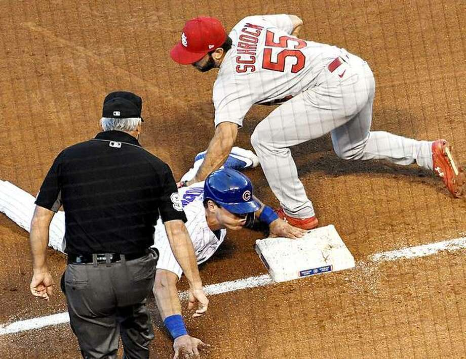 Cardinals third baseman Max Schrock (55) tags out Cubs' Nico Hoerner (2) at third base in the seventh inning of Game 2 of Wedcnesday's doubleheader in Chicago. Photo: AP Photo