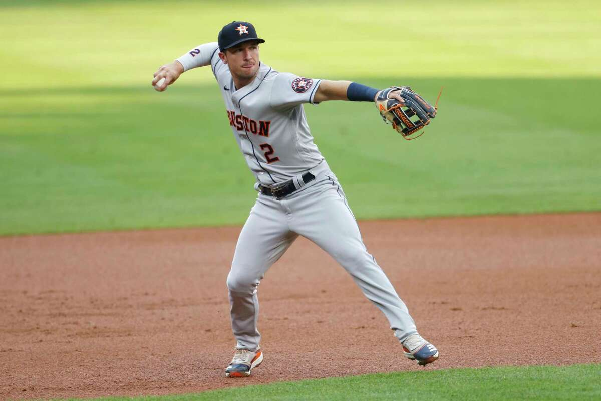 Houston Astros third baseman Alex Bregman throws to first base to put out Colorado Rockies' Trevor Story in the first inning of a baseball game Wednesday, Aug. 19, 2020, in Denver. (AP Photo/David Zalubowski)