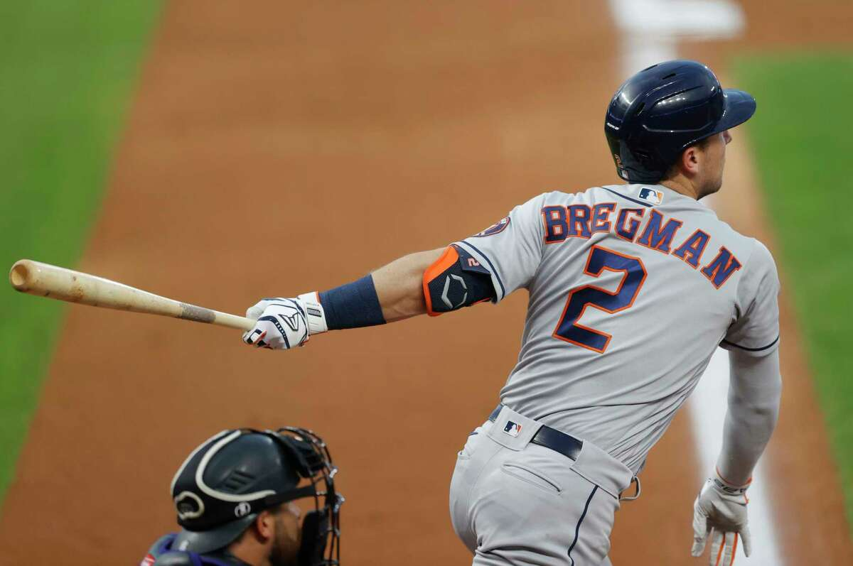 Houston Astros' Alex Bregman follows the flight of his double to lead off the fourth inning of a baseball game Wednesday, Aug. 19, 2020, in Denver. Bregman limped to second base and was removed from the game before play resumed. (AP Photo/David Zalubowski)