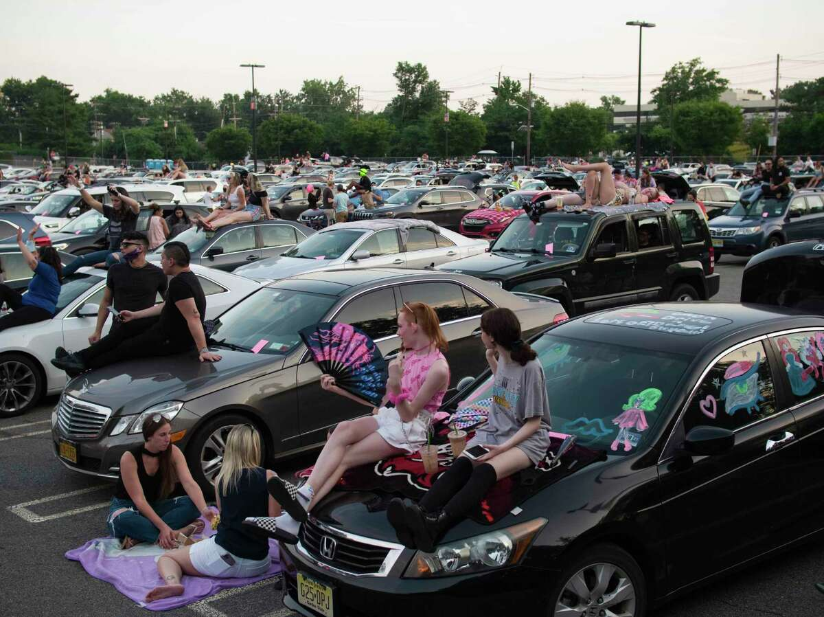 This photo provided by Polk Imaging shows Drive 'N Drag at Westfield Garden State Plaza, in Paramus, N.J. After being closed for months due to the pandemic, malls are bringing all types of drive-in entertainment to their massive parking lots, hoping to lure people back to their properties. (Dave Kotinsky/Polk Imaging for Westfield via AP)