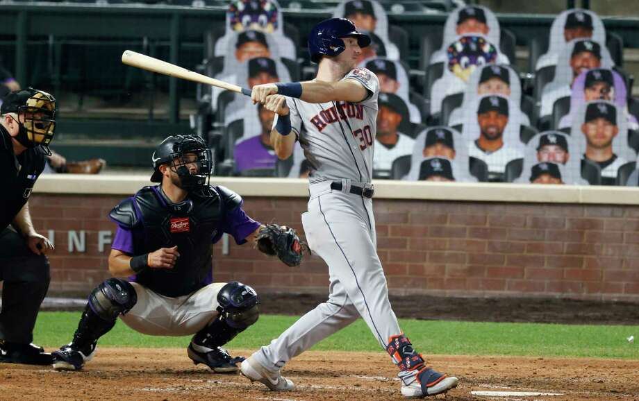 Houston Astros' Kyle Tucker, right, follows the flight of his ball that went for a triple to drive in two runs in the sixth inning of a baseball game Wednesday, Aug. 19, 2020, in Denver. (AP Photo/David Zalubowski) Photo: David Zalubowski, Associated Press / Copyright 2020 The Associated Press. All rights reserved.