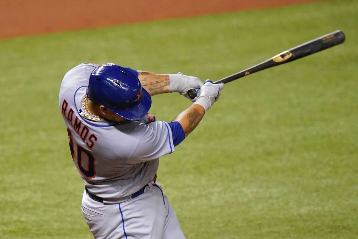 New York Mets' Wilson Ramos hits a single during the fifth inning of a baseball game against the Miami Marlins, Wednesday, Aug. 19, 2020, in Miami. (AP Photo/Lynne Sladky)