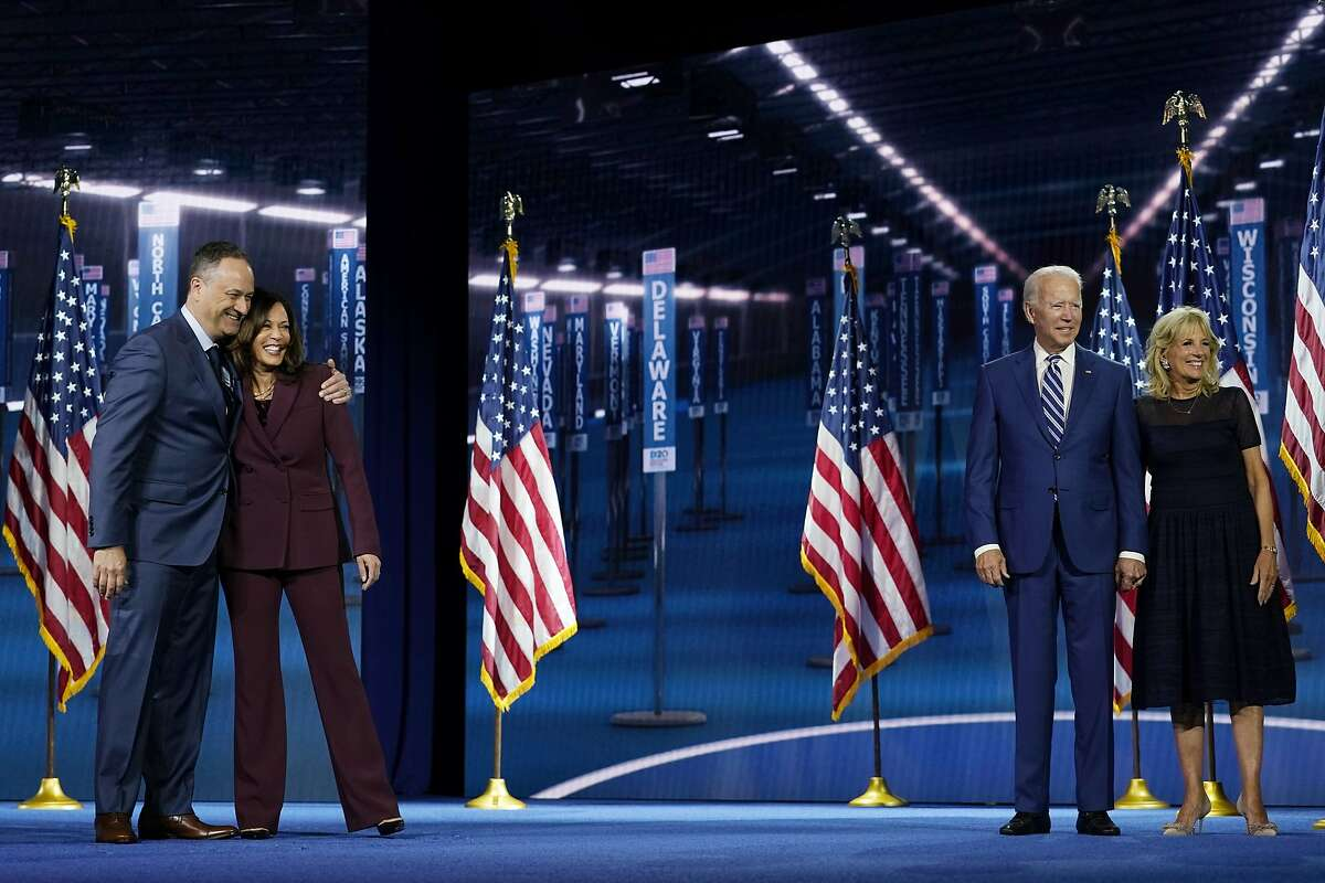 Democratic vice presidential candidate Sen. Kamala Harris, D-Calif., is joined on stage by her husband Doug Emhoff and Democratic presidential candidate former Vice President Joe Biden, and his wife Jill Biden, after she spoke during the third day of the Democratic National Convention, Wednesday, Aug. 19, 2020, at the Chase Center in Wilmington, Del. (AP Photo/Carolyn Kaster)