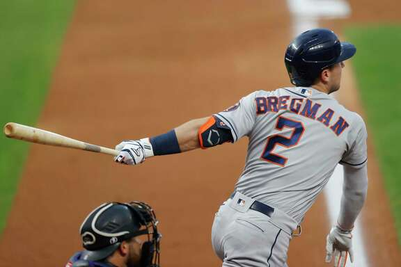 Alex Bregman follows the flight of his fourth-inning double, on which he injured his hamstring Wednesday night.