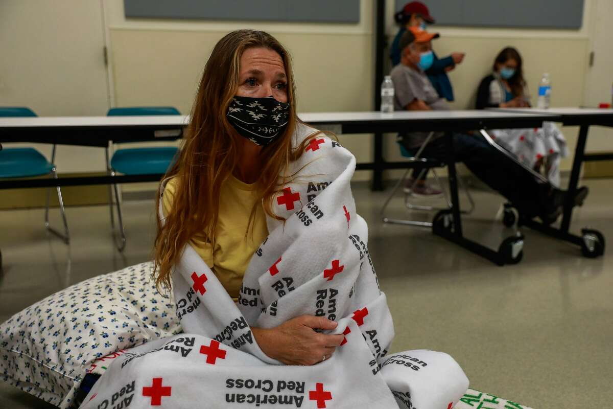 Evacuee Shawnee Whaley, 57, who believes her house burned down sits in the Red Cross Shelter at the Ulatis Cultural Center after escaping the LNU Lightning Complex Fire in Vacaville , Calif., on Wednesday, August 19, 2020.