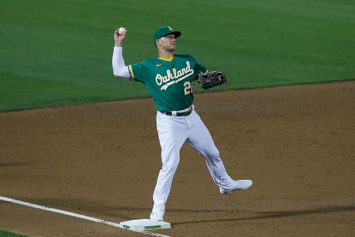 OAKLAND, CALIFORNIA - AUGUST 19: Matt Chapman #26 of the Oakland Athletics completes a double play in the top of the sixth inning against the Arizona Diamondbacks at Oakland-Alameda County Coliseum on August 19, 2020 in Oakland, California. (Photo by Lachlan Cunningham/Getty Images)