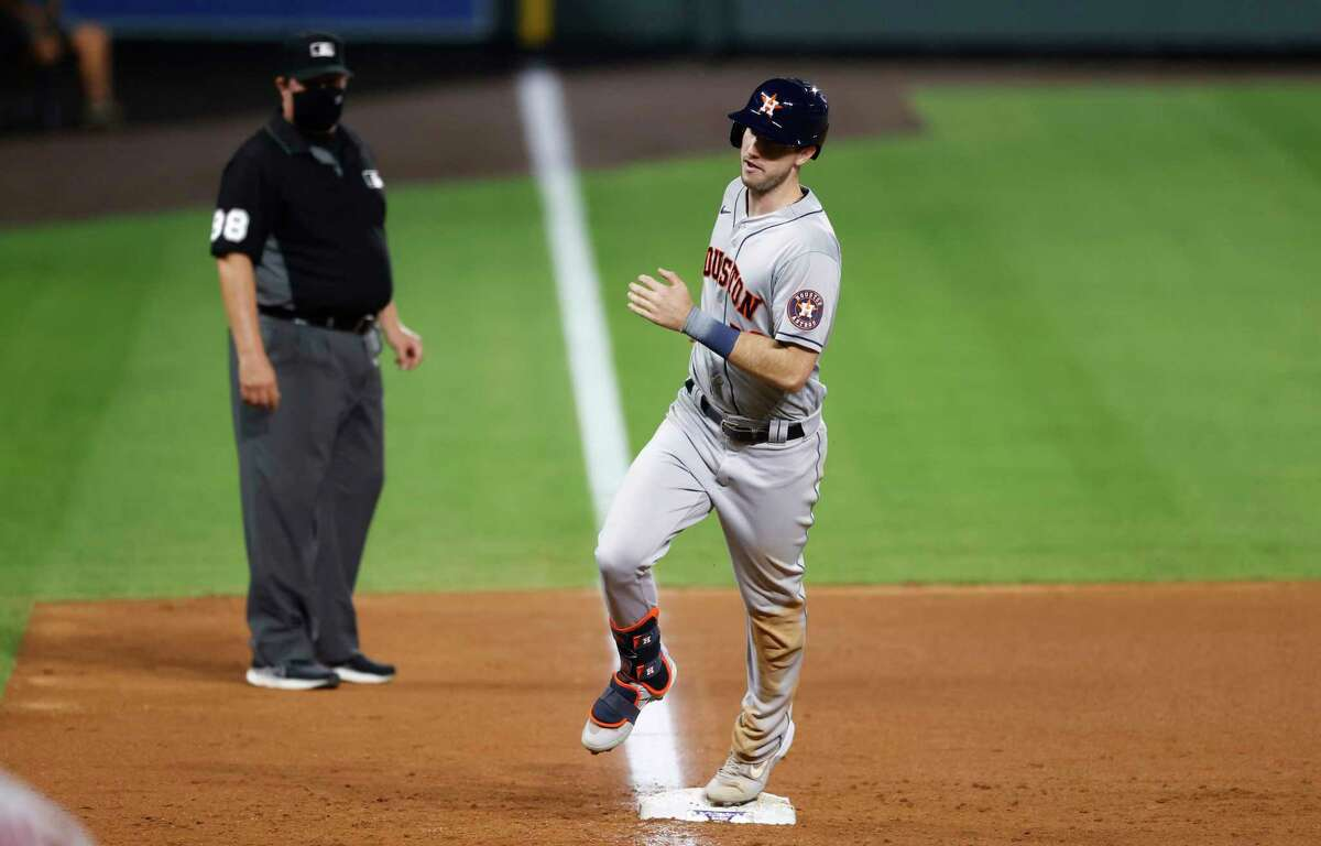 Houston Astros' Kyle Tucker circles the bases after hitting a two-run home run off Colorado Rockies relief pitcher James Pazos in the ninth inning of a baseball game, Wednesday, Aug. 19, 2020, in Denver. Houston won 13-6. (AP Photo/David Zalubowski)