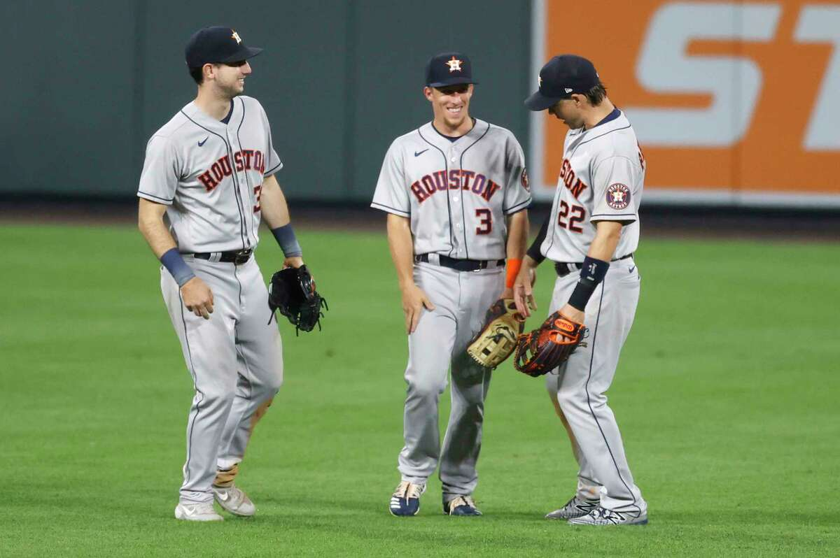 Houston Astros right fielder Kyle Tucker, center fielder Myles Straw and right fielder Josh Reddick, from left, celebrate the team's 13-6 win in a baseball game against the Colorado Rockies on Wednesday, Aug. 19, 2020, in Denver. (AP Photo/David Zalubowski)