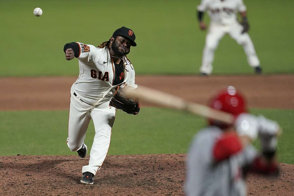 San Francisco Giants' Johnny Cueto, left, pitches to Los Angeles Angels' David Fletcher during the sixth inning of a baseball game in San Francisco, Wednesday, Aug. 19, 2020. (AP Photo/Jeff Chiu)