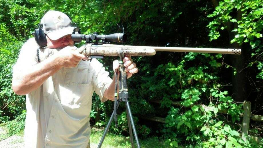 """Tom staying in tune with his """"elk rifle"""" while using tri-podTrigger-Sticks which can be readily used during the hunt for a stabileshooting rest. (Tom Lounsbury/Hearst Michigan)"""