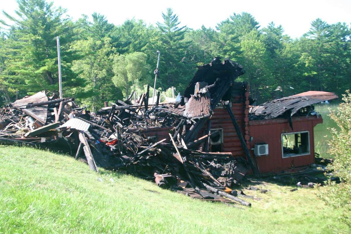 Little remains but a pile of debri on the site of the Government Lake Lodge, which burned to the ground on Wednesday, Aug. 12. Fire fighters from several departments in the county were on hand to help put out the blaze. The cause of the fire remains unknown. (Star photo/Cathie Crew)
