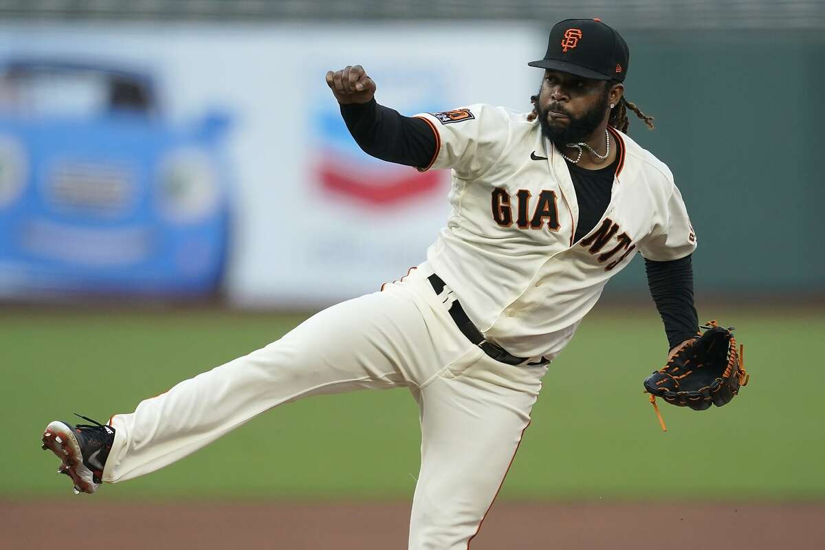 San Francisco Giants pitcher Johnny Cueto throws against the Los Angeles Angels during the first inning of a baseball game in San Francisco, Wednesday, Aug. 19, 2020. (AP Photo/Jeff Chiu)