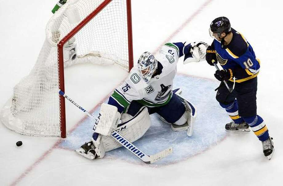 The Blues' Brayden Schenn (10) is stopped by Vancouver Canucks goalie Jacob Markstrom (25) during the third period Wednesday night in Edmonton. Photo: AP Photo
