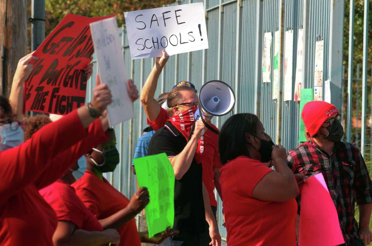 Dozens of teachers protest going back to school without proper safety protocols in place during a Bridgeport Board of Education meeting at the Aquaculture Education Center in Bridgeport on Aug. 6.