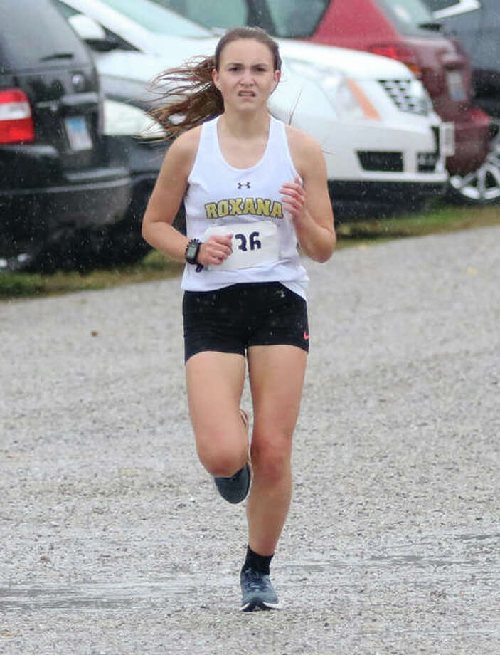 Roxana senior Keiko Palen runs in the rain during last season's New Athens Class 1A Regional. Palen, who ran fifth in the regional, and classmate Janelynn Wirth return to lead what project as a big season for Shells girls cross country. Photo: Greg Shashack | The Telegraph
