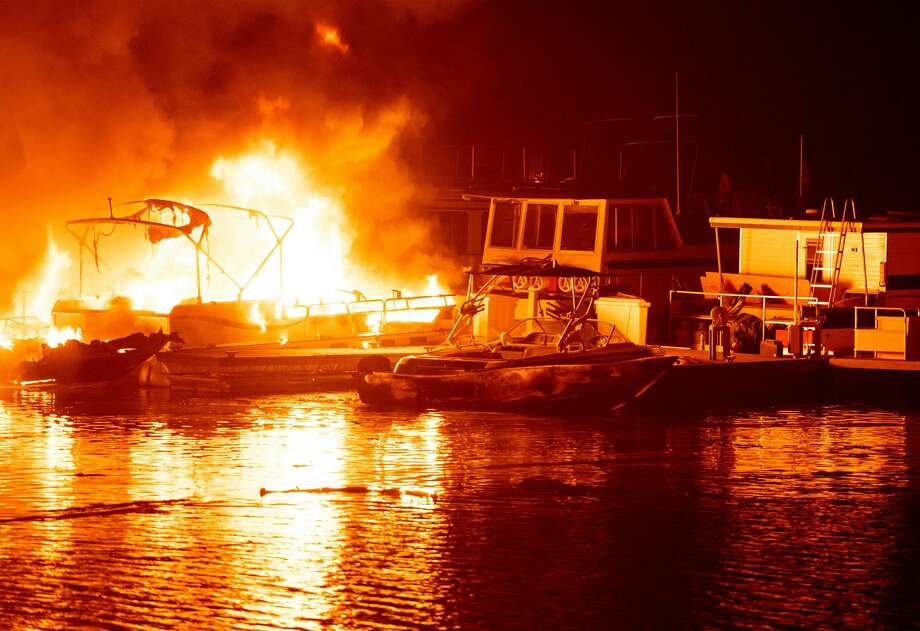 Docked boats burn on Lake Berryessa during the LNU Lightning Complex fire in Napa, California on August 19, 2020. Photo: Josh Edelson/AFP Via Getty Images / AFP or licensors