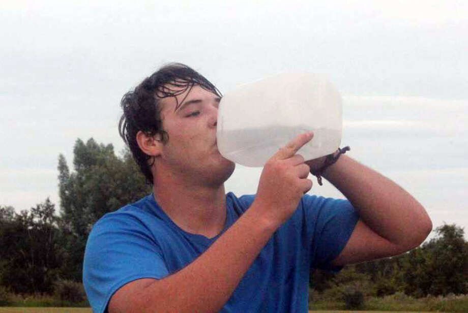 Big Rapids lineman Austin Maneke takes a drink after a summer practice. Photo: Pioneer Photo/John Raffel