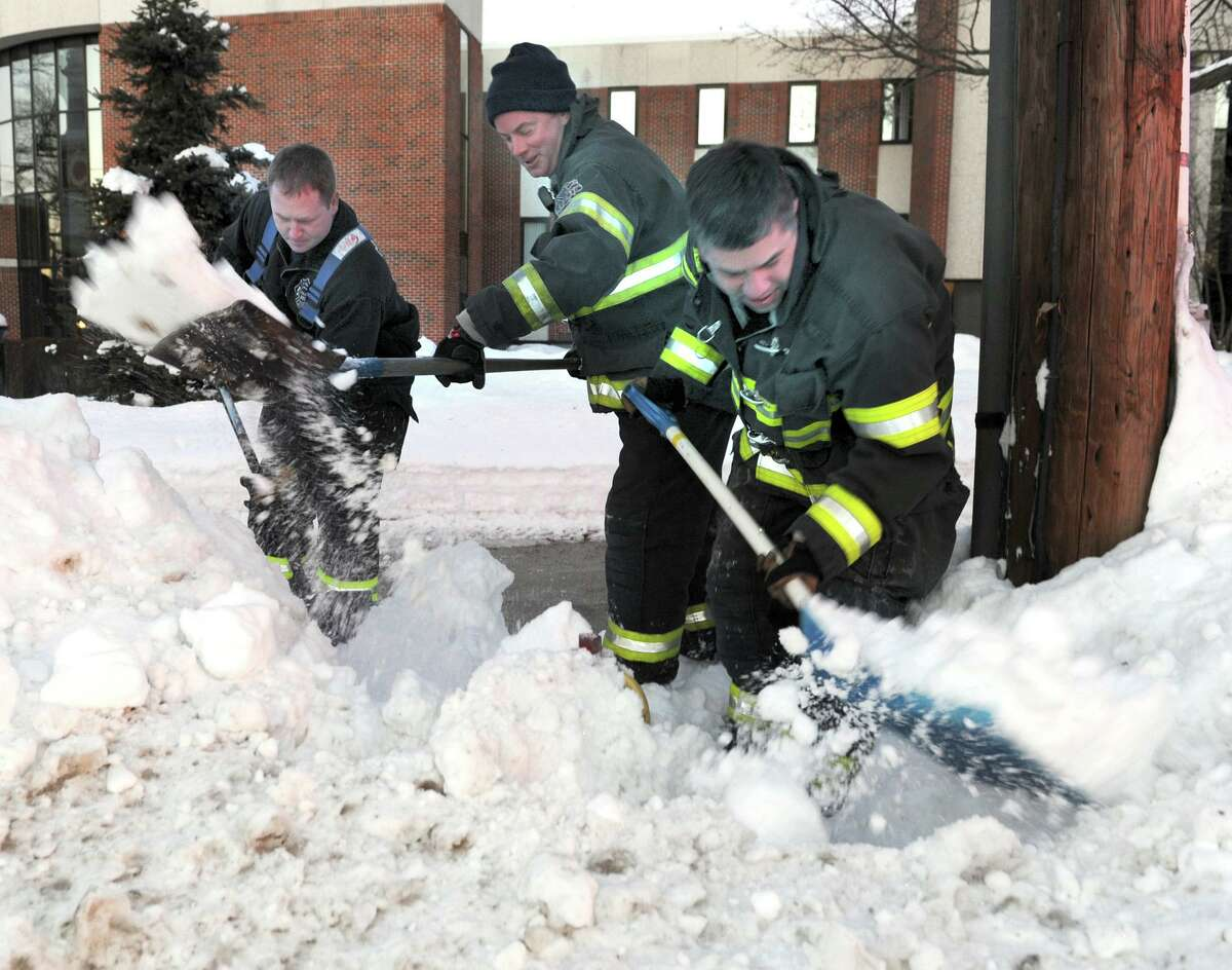 Danbury Firefighters from Engine 21, from left, Mike Jewell, Bill Ratajack and Lt. Bill Lounsbury, dig out a fire hydrant in front of City Hall in Danbury Friday afternoon. Photo taken January 14, 2011. Jewell has been with the department since January 1996 and served as fire dispatcher from 2013 to 2015. He also received the Sunshine Rotary Club's Firefighter of the Year Award in 2013. He earned the No. 1 rank on the deputy fire marshal eligibility list, the mayor said in an April letter. City Council approved Hanson and Guard's appointments this week, while Jewell's was granted in April. A video of the swearing-in ceremony is on the department's Facebook page.