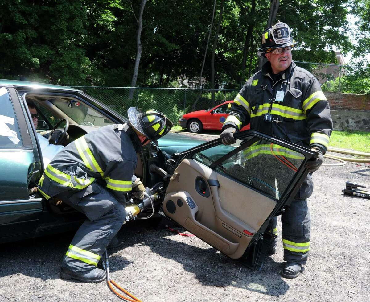 Firefighter Shea Hanson, left, and Lt. Pat Corbett demonstate using the jaws of life to take a door off a car. The Danbury Fire Department on New Street held an open house on Saturday, June 26, 2010. Lt. Shea Hanson was promoted to fire captain, while firefighter Mike Jewell and Lt. Ray Guard were named deputy fire marshals. Hanson joined Danbury Fire Department in July 2006 after serving as a volunteer firefighter and 911 dispatcher. He became a lieutenant in March 2014, according to a letter from the mayor to City Council.