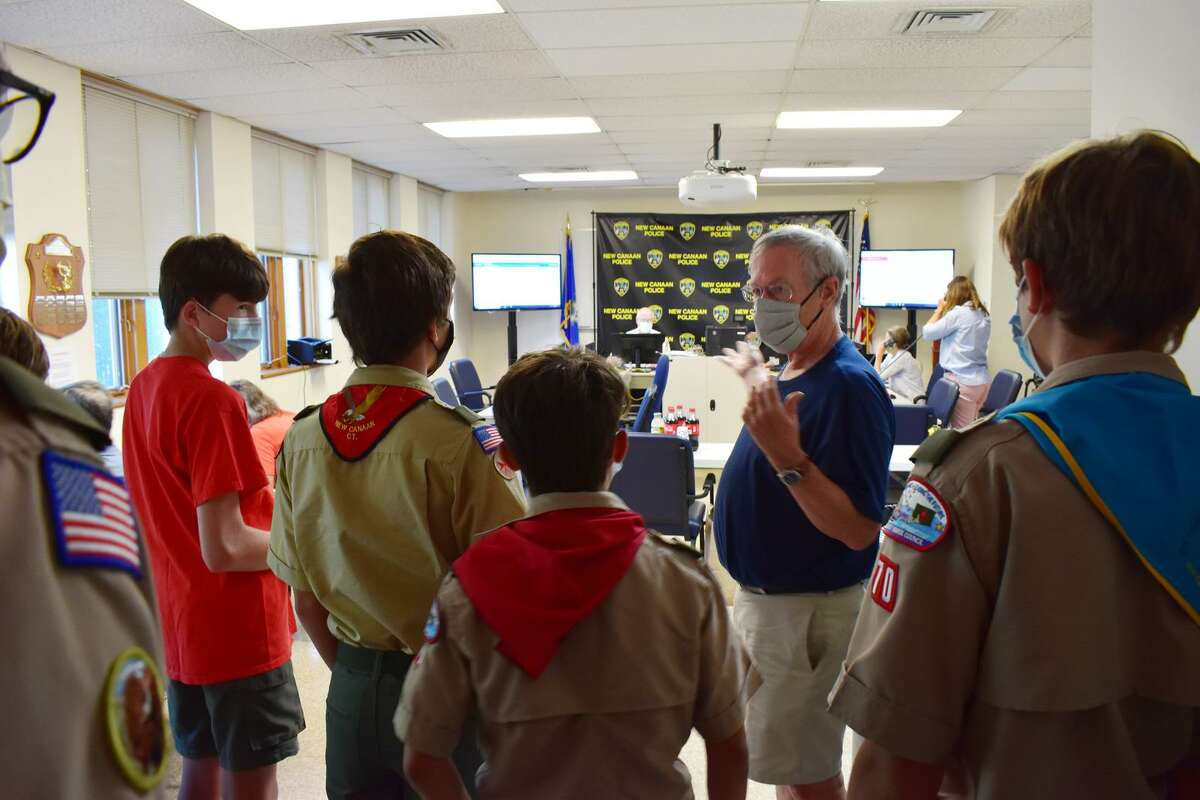New Canaan Community Emergency Response Team, (CERT), Deputy Director Peter Bergen explains the inner workings of the town's Emergency Operations Center to Boy Scouts from Troop 70 during a recent tour of the center. The Scouts meet weekly at St. Mark's Episcopal Church. The tour allowed them to experience the cleanup from the recent Tropical Storm Isaias. Several of the Scouts also worked toward obtaining their Emergency Preparedness Merit Badge.