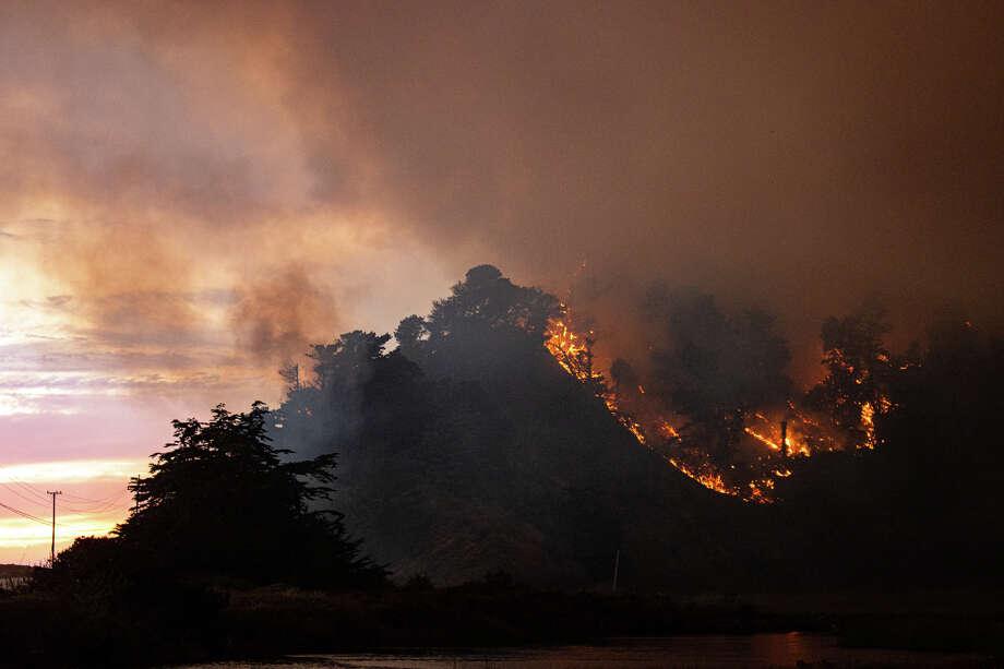 The CZU Lightning Complex Fire burns near Waddell Creek on Aug. 18, 2020. Photo: Sean Vanderaa/@svexposures / @svexposures